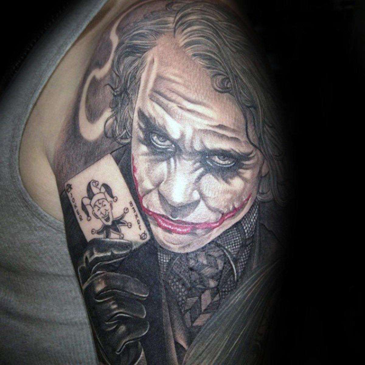 half-sleeve-joker-with-playing-card-tattoos-for-guys