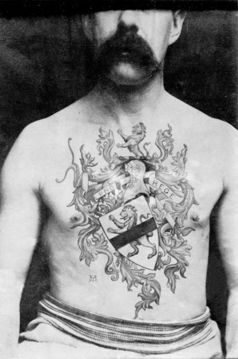 Man with coat of arms tattoo across his chest, done by Sutherland Macdonald. Photo: National Maritime Museum Cornwall.