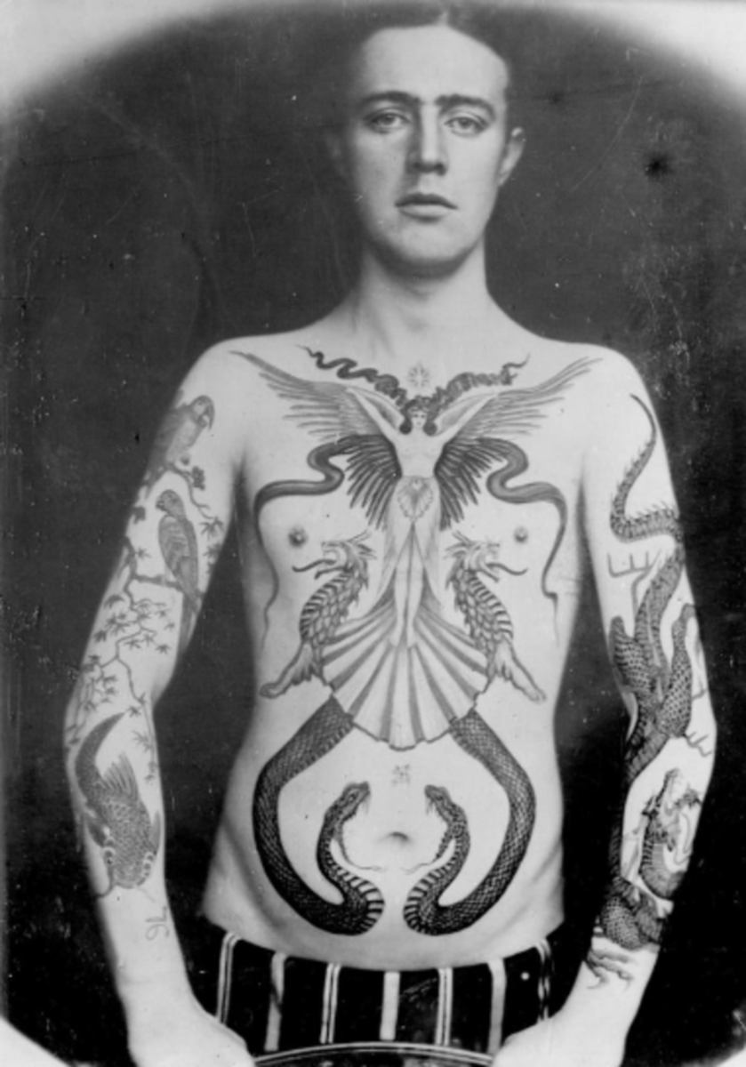 "Man displaying a spectacular winged woman surrounded by dragons and snakes across his chest and abdomen, as well as dragons and birds pieces on his arms. All done by Sutherland Macdonald. Photo: National Maritime Museum Cornwall. The National Maritime Museum Cornwall in England recently launched an exhibit titled Tattoo: British Tattoo Art Revealed is a ""ground-breaking and comprehensive history of British tattooing,"" according to the museum's website. Featuring over 400 historic artifacts, original artwork and photographs all dealing with tattoo art, one part of the exhibit that's gaining major attention are the photographs of the work of a Victorian era tattoo artist by the name Sutherland Macdonald."