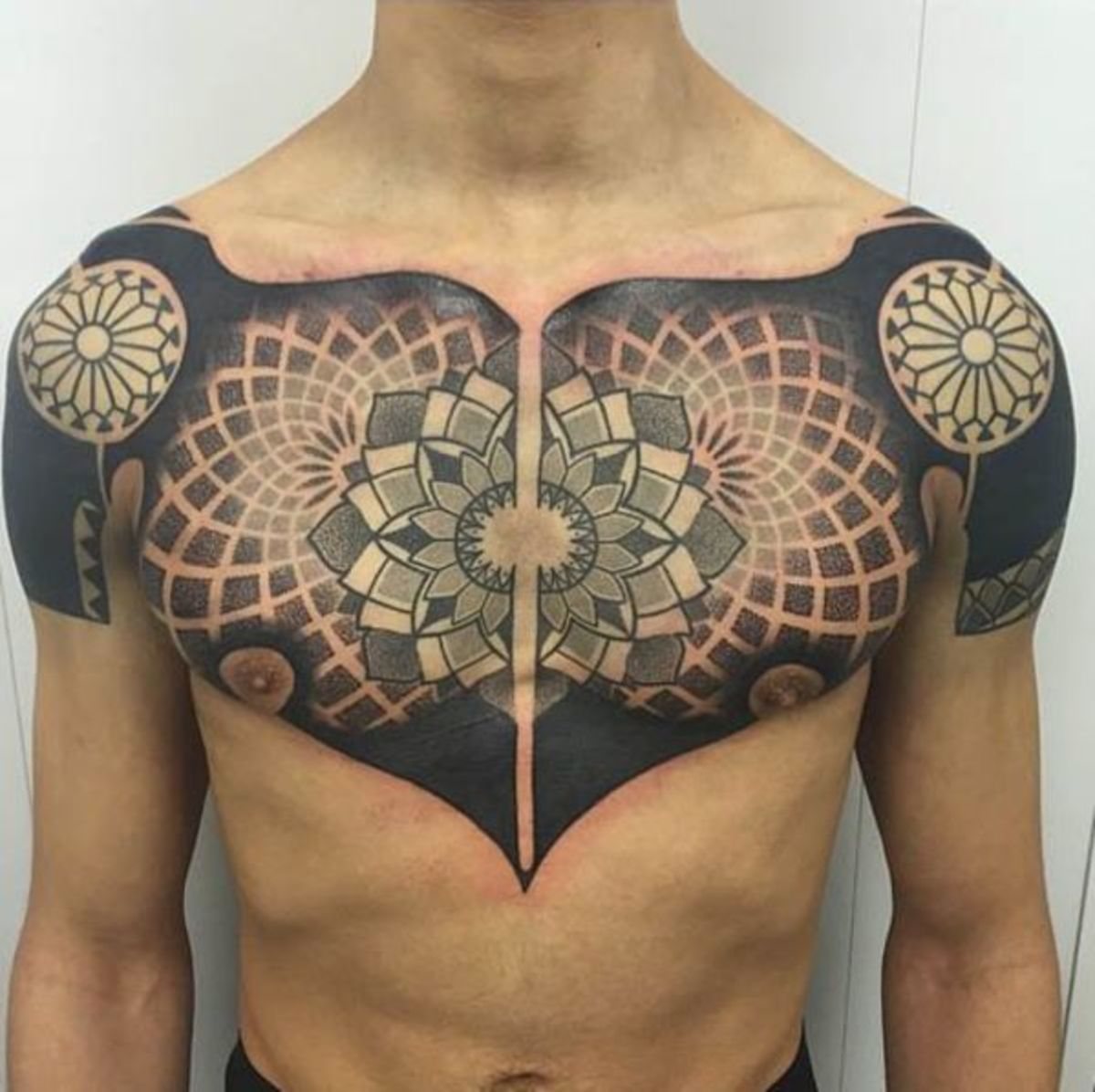Geometric and Mandala Designs The way that geometric and mandala designs enhance the lines of a man's body really enhance his attractiveness.