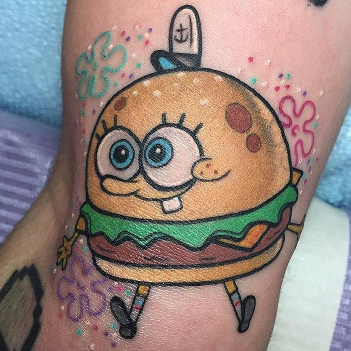 Who lives in a pineapple under the sea? Sponge Bob Cheese Burger! Tattoo by Alex Strangler
