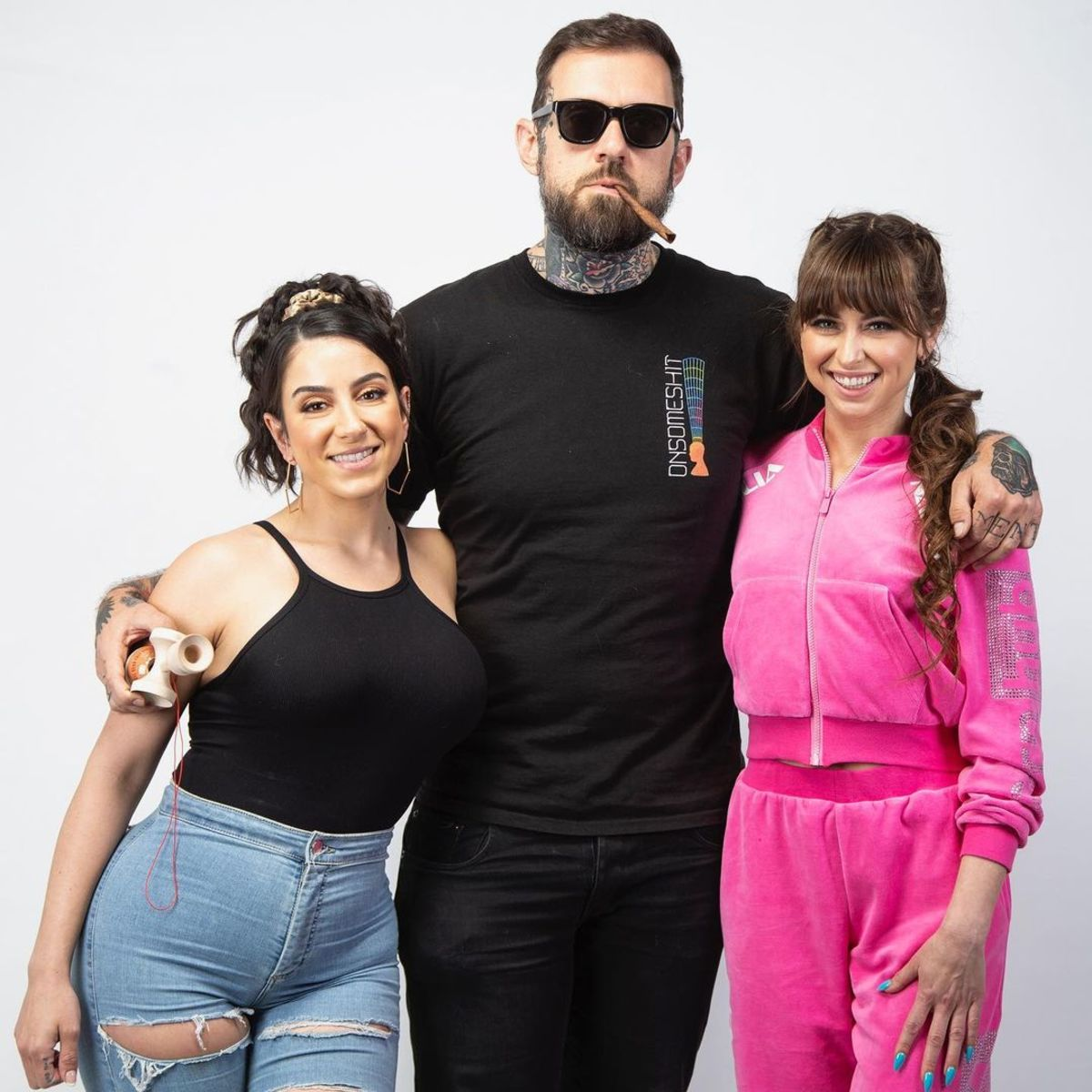 Grandmaison (center) pictured with his partner and top OnlyFans creator Lena Nersesian (left) and AVN award-winning performer Riley Reid (right). Photo via @adam22